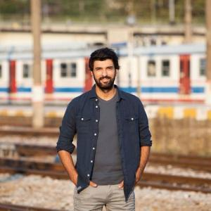 Engin Akyurek in train station