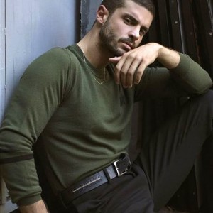 Berk Oktay green sweater