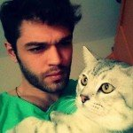 Furkan Andic with white cat