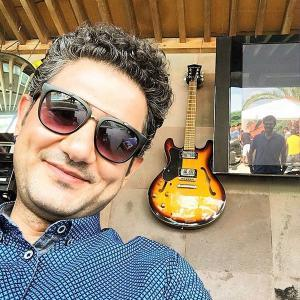 Cihan Ercan with guitar