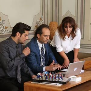 Kadir working with his friends in office